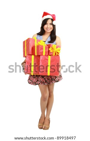 Christmas shopping woman holding gifts wearing red Santa hat isolated on white background. - stock photo
