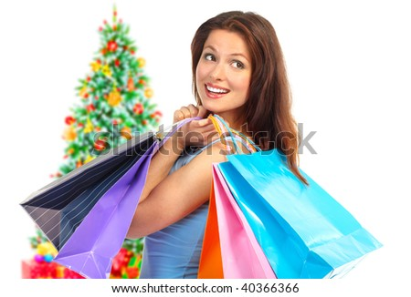 Christmas shopping  woman smiling. Isolated over white background