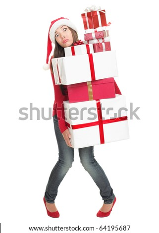 Christmas shopping woman stressed with funny expression holding many gift boxes. Full length Isolated on white background.