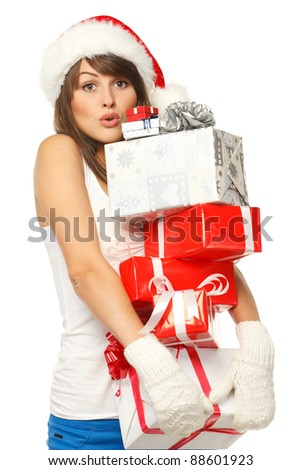 Christmas shopping woman with funny expression holding many gift boxes over white background. - stock photo