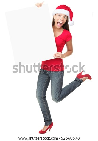 Christmas sign excited woman looking happy and surprised. Funny asian caucasian female model standing full body isolated on white background. - stock photo