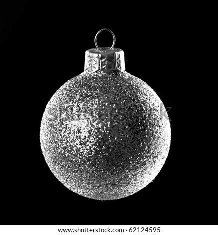 Christmas silver ball isolated on black background - stock photo