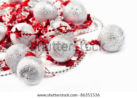 Christmas silver balls and red stars on white - stock photo