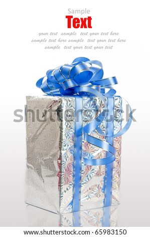 Christmas Silver gift box tied with blue ribbon bow on white background - stock photo