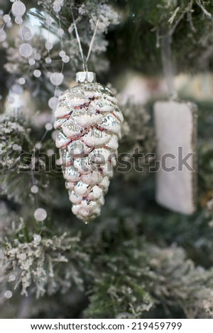Christmas silver pine cone decoration toy on the christmas tree - stock photo
