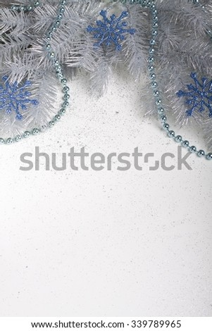 Christmas silver twig with blue snowflakes and chain.  - stock photo