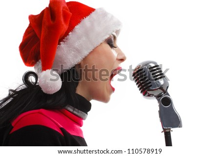 Christmas Singer standing in front of a microphone. Isolated on a white background - stock photo