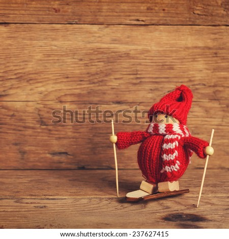 Christmas  skier in snow on wood background - stock photo