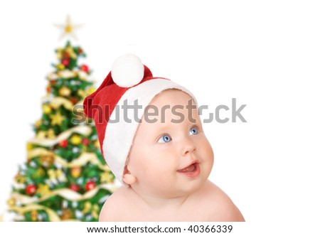 Christmas smiling baby.  Isolated over white background