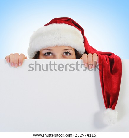 Christmas smiling woman in red santa cap - stock photo