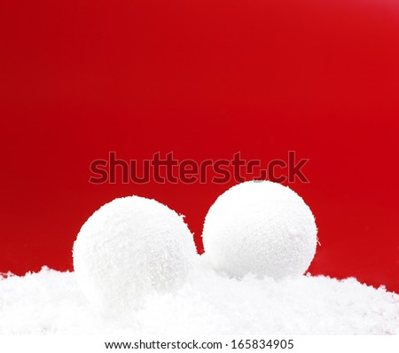 Christmas Snowballs Isolated on the snow and red background - stock photo