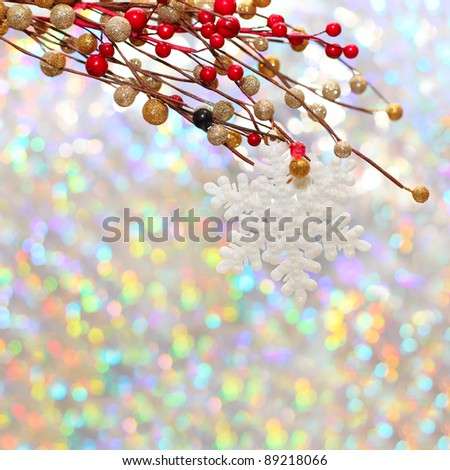 Christmas snowflake and decoration on silver background - stock photo