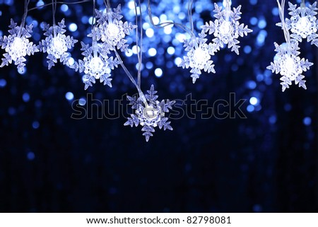 Christmas snowflake lights with copyspace - stock photo