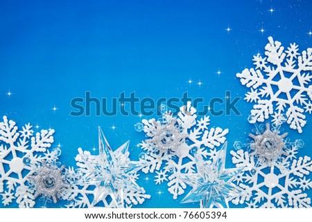 Christmas snowflake on blue background - stock photo