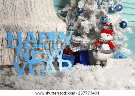 Christmas snowman under the Christmas spruce - stock photo
