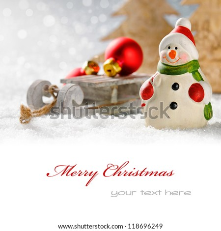 Christmas snowman with presents in winter forest with copyspace - stock photo