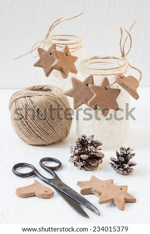 Christmas Snowy Mason Jars with Cinnamon Star and Heart Cookies and Pine Cones - stock photo