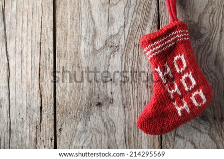 Christmas sock on grunge wood - stock photo