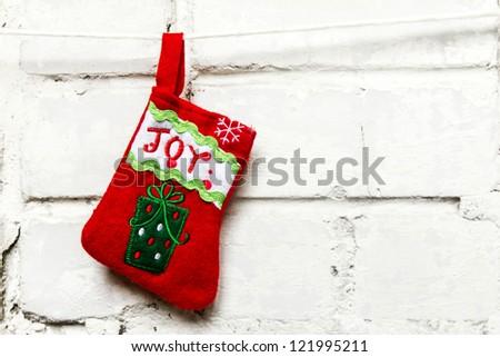 Christmas sock on the white wall - stock photo