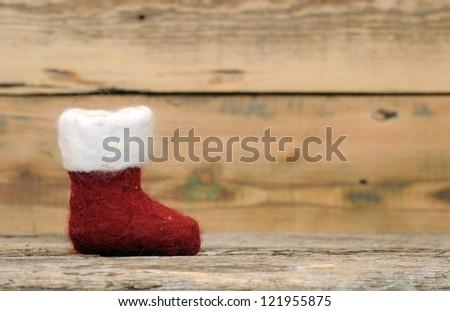 Christmas sock on wood - stock photo
