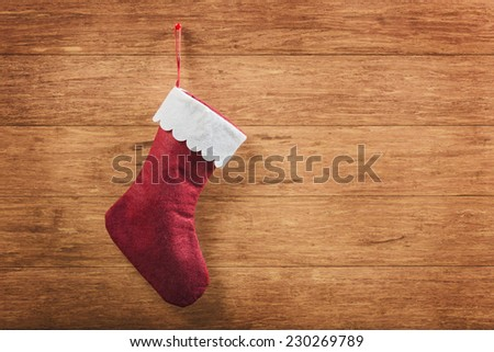 Christmas sock  on wooden background - stock photo