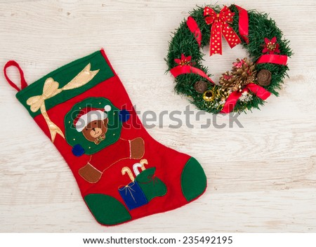 Christmas Sock on wooden background.