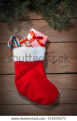Christmas sock on wooden boards
