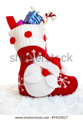 christmas sock with present isolated on white background