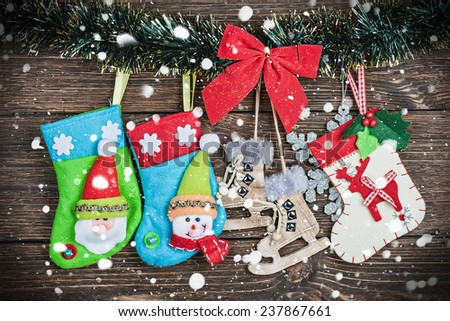 Christmas socks hanging on the wooden background - stock photo
