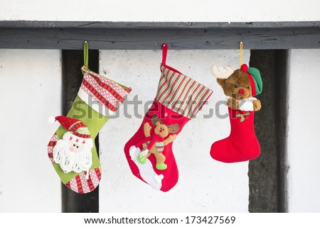 Christmas socks with gifts hanging isolated on a white background