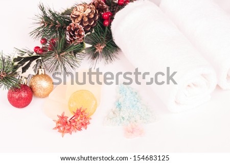 Christmas spa concept with xmas tree shaped bath salts, soaps, baubles and towels close up