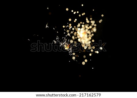 Christmas sparkler firework flame on black - stock photo