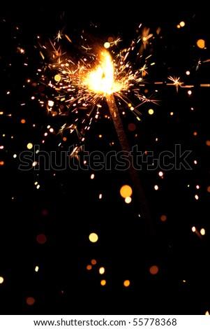 christmas sparkler on black - stock photo