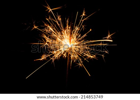 Christmas sparkler on black background. Bengal fire - stock photo