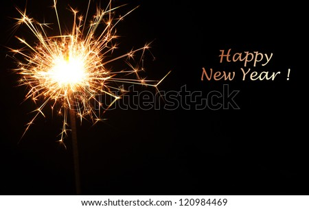 Christmas sparkler on black background. Bengal fire. New year or birthday background - stock photo