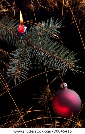 Christmas sparkler twig with red ball - stock photo