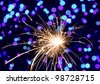 Christmas sparklers and background with colorful bokeh - stock photo
