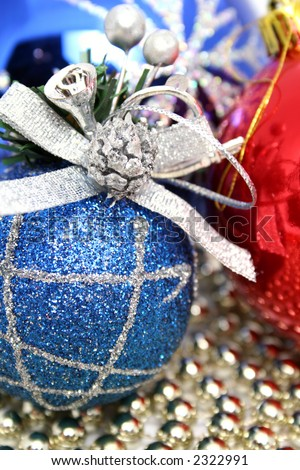 Christmas spheres of various color with a pattern on a background of a multi-coloured beads - stock photo