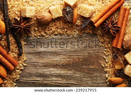 Christmas spices and baking ingredients on wooden background - stock photo