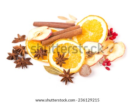 Christmas spices and dried orange sliceson - stock photo