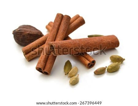 Christmas spices (cinnamon sticks, star anise, clove, walnut  - stock photo