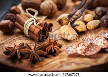 Christmas spices, nuts and baking ingredients - stock photo