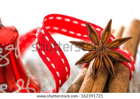 Christmas spices on wooden background