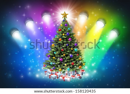 Christmas spotlights with rainbow colors as a festive magical abstract background of winter and new year celebration with lights shinning on a decorated pine tree with gifts and a glowing star. - stock photo