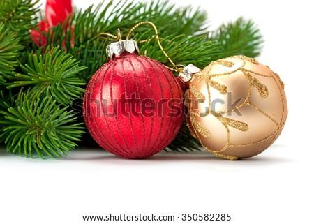 Christmas spruce sprigs and beautiful shiny balls isolated on white background - stock photo