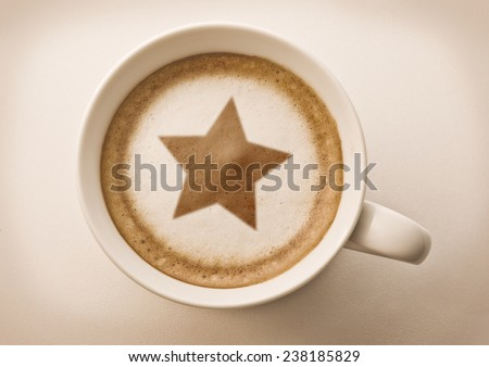 christmas star drawing on latte coffee cup  - stock photo