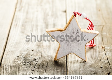 Christmas star made of wood with rope standing on wooden background - stock photo