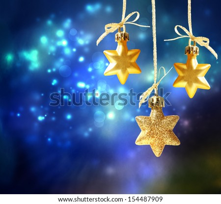 Christmas star ornaments in the night - stock photo