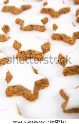 Christmas star shaped cookies with white icing on white background - stock photo