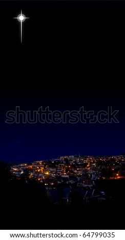 Christmas star shining over a modern, western village; excellent copy-space in sky and village foreground; star may be easily repositioned - stock photo